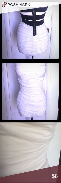 Forever 21 strapless dress Super cute dress with design out back. Dress is made with a knit material and does have some pilling on the front reflected on price. I have also picture the pilling on the last picture. Wore it once Forever 21 Dresses Mini