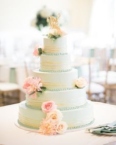 "Style Me Pretty on Instagram: ""We love a #traditional #weddingcake in a fun #mint hue topped off with fresh #flowers and a #sparkly #gold #cake topper! 