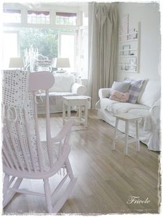 small bedroom, pink chair; whites
