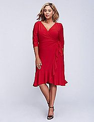 Whimsy wrap dress by Kiyonna elicits a few wows with its curve-contouring style and flirty ruffled trim. In a soft knit for a comfortable, flattering drape, the wrap styling lets you adjust the fit to your most flattering with an attached tie belt closure for a secure fit. 3/4 sleeves with shirred shoulder detail.  lanebryant.com