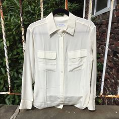 Cream Silk Button Down Blouse (NWOT!!!) This is a brand new, never worn silk blouse from the French brand Equipment. It doesn't have tags but is in perfect condition. This is the brand's Signature Blouse in Natural White which is a cream color. It's a size XS but it runs quite big - it would fit a S. Equipment Tops Button Down Shirts