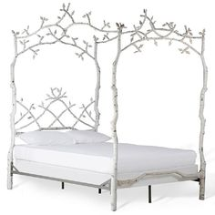 This beautiful bed is crafted with forged iron and hand-painted in a clean, white color. The intricate leaf-design is accented with antique finishes.