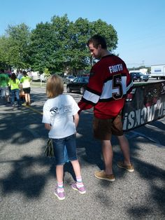 Carter Foguth talks to a young fan who helped the Jacks out during the Roosevelt Park Parade on Saturday, August 25!