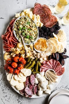 How to build a dinner-worthy charcuterie board with ideas for what to put on a cheese and charcuterie board and tips and tricks for arranging a showpiece platter! Plus all the components of an Italian Salumi themed charcuterie board! Charcuterie Recipes, Charcuterie Platter, Charcuterie And Cheese Board, Cheese Boards, Charcuterie For Dinner, Party Food Platters, Cheese Platters, Tapas, Plateau Charcuterie