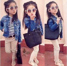 Very chic look for a toddler girl. She even has her own handbag and sunglasses.