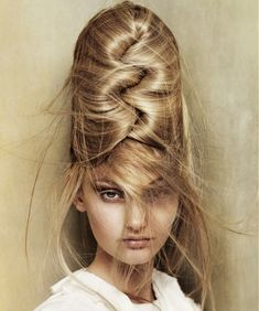 A long blonde straight coloured sculptured updo beehive hairstyle by Angelo Seminara