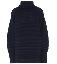 Victoria Victoria Beckham - Wool turtleneck sweater - Update your essential knitwear edit with Victoria Victoria Beckham's woollen style. This ribbed piece comes in an oversized fit with an exaggerated collar and cuffs, while the classic navy hue keeps the design versatile. seen @ www.mytheresa.com