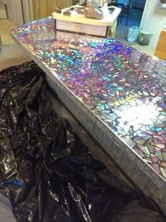 """Remodeling Kitchen Countertops """"I wish I'd seen this before throwing out my old cd's!"""" said a reader when she saw what this woman did to her kitchen countertops: - This is the coolest thing you'll see all day! Faux Brick Panels, Brick Paneling, Diy Concrete Countertops, Kitchen Countertops, Countertop Materials, Gemstone Countertops, Epoxy Resin Countertop, Cd Crafts, Resin Crafts"""
