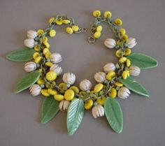 Vintage Miriam Haskell necklace. Love it. - HASKELL Hess yellow glass buttons and white enameled daisies with green pressed glass pate de verre leaves necklace.