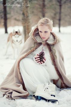 Winter bride with a vintage cape and her huskies!