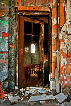 Abandon, Old, Worn down, but uniquely beautiful in it's own way. I imagine this door has seen a LOT of folks come and go.