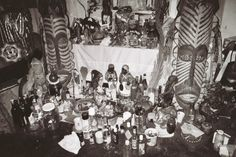 Lit by the Victorian transom arched window is a voodoo altar dedicated to Papa Legba. Upon this candle-covered ledge are such items as messenger dolls petitioning the lwa spirits, Hoodoo bottles and and a Black Madonna doll's head.