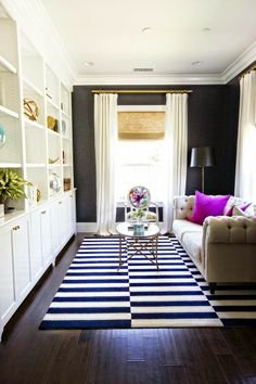 Office!! Hmmm see navy walls pop off a lot of white cabinetry and decorative built ins. Then cozy furnishing softens it