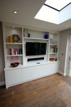 Bespoke contemporary unit in Wandsworth Living Room Built In Units, Built In Tv Wall Unit, Bookcase Wall Unit, Living Room Bookcase, Living Room Tv Unit Designs, Ikea Living Room, Living Room Storage, Wall Shelving, Playroom Storage