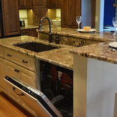 kitchen islands with sink, dishwasher and seating