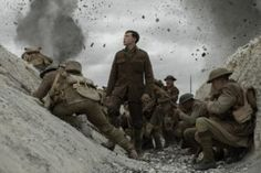 Comment: This image released by Universal Pictures shows George MacKay, center, in a scene from directed by Sam Mendes George Mackay, Dean Charles Chapman, Kirk Douglas, Colin Firth, Jake Gyllenhaal, Skyfall, Black Sheep Squadron, Les Oscars, The Walking Dead