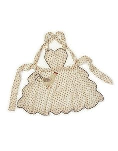 The heart-shaped bodice aprons stayed popular for decades. The pattern for these were often found in newspapers and magazines.