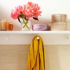 A shallow shelf with hooks helps a small room feel larger and provides extra storage! See more savvy storage ideas: http://www.bhg.com/decorating/storage/