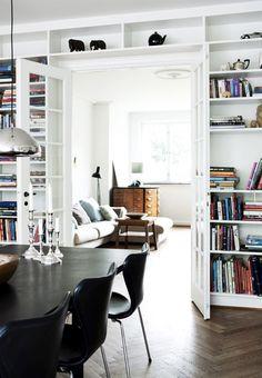 Built-in bookcase surrounding door in dining room, looking into living room