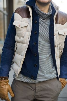 The blue jacket is just enough to pop in between the layers of earth tones.