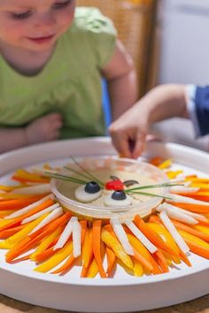 Lion Vegetable Tray. 30 Best Foods to Make for Your Kid's Birthday Party #purewow #family #cooking #recipe #easy #food #partyfood #birthdaypartyfood #kidsbrithdayideas #kids #family #liontray #lion #veggies #vegetabletray #kidsfood