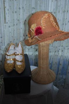"""of my favorite 1920's straw hat. I wear this in the summer. I really love this hat. Love the gold 1920's shoes. I can see some young woman dancing the Charleston in these shoes. They are tiny!!!!"""""""