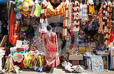 Bold hindu woman watching religious articles in Srirangam