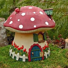 Red Mushroom Solar Fairy Cottage This whimsical fairy house is from the Merriment collection designed by artist Mary Engelbreit. The cottage has a hinged door that opens to reveal a little green frog Flower Pot Crafts, Fairy Crafts, Clay Pot Crafts, Garden Crafts, Flower Pots, Garden Art, Diy Clay, Solar Fairy House, Fairy Garden Houses