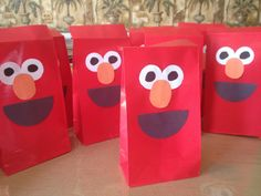 Elmo sesame street party bags. Red bags from the dollar tree party section. Black and orange construction paper and a sharpie for the eyes. Hot glue on bag and done! I like them free handed because imperfection in my eyes is better than precision cut when made by hand :)