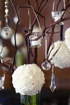 Carnation pomanders+votives+branches=a beautiful, original winter look