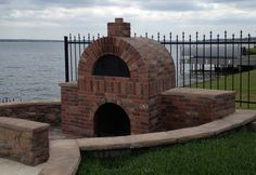 Amerigo™ with side cabinets overlooking a lake. What a beautiful setting.
