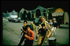 "Filming of ""West Side Story"" in Jets, led by Russ Tamblyn (yellow jacket) as Riff, chase George Chakiris (red shirt), as Bernardo, leader of the Sharks. 1961 Movies, Old Movies, West Side Story 1961, George Chakiris, Dance Like No One Is Watching, Love Film, Life Pictures, Life Photo, Picture Collection"
