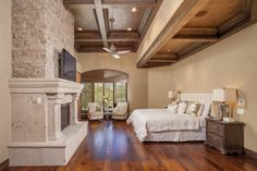 Enter the stunning master suite at Shadow Peak through an arched wooden doorway, and you will be surrounded with comfort and refinement. The large bay window, stone & Cantera fireplace, private balcony with endless desert views make relaxation easy to come by.  #SupremeAuction #LuxuryAuction #Scottsdale #Phoenix #Arizona #ScottsdaleRealEstate #SonoranDesert #ArizonaRealEstate #Troon #TroonVillage #Auction #Artesano