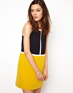 Yellow and black color block mod dress with white piping