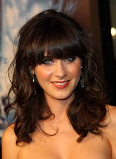 Medium length curly hair with straight across bangs