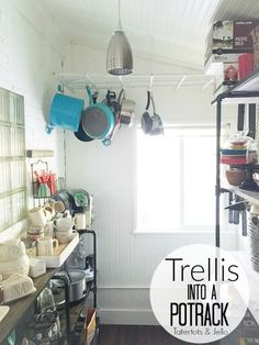 Easy DIY Potrack! Take a garden trellis and turn it into an easy DIY pot rack! Great tutorial on maximizing the space in your kitchen!
