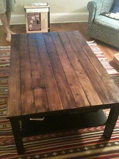 The Feminist Mystique: DIY Rustic Wood Coffee Table/Farm Table - love it, use an existing coffee table and add stained wood to the top... too bad I have too many other coffee table ideas that will probably beat this one to the top of my to do list! :)