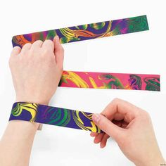 Cool and groovy fashion bracelet. Assorted tie-dyed color slap bracelets add a retro touch to any party occasion. Slap them on and peace out at your next sixties or eighties theme party.