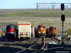 BNSF #3948 (GE ET44C4) West overtakes another westbound at Connell, WA on 02 April 2017. Photo by Brian Ambrose.