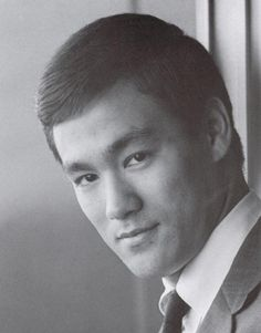In 1959 a short, skinny, bespectacled Bruce Lee from Hong Kong traveled to America and declared himself to be John Wayne, James Dean, Charles Atlas and the guy who kicked your butt in junior high. In an America where the Chinese were still stereotyped as meek house servants and railroad workers, he was all steely sinew, threatening stare and pointed finger: a Clark Kent who didn't need to change outfits. He was the redeemer. Lee tragically succumbed to a brain aneurysm on July 20th, 1973.