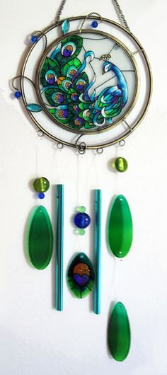I like the open space between rings with a glass design in the center ( a peacock here) and wind chimes hanging. Stained Glass Birds, Stained Glass Projects, Stained Glass Patterns, Stained Glass Windows, Fused Glass, Mobiles, Sun Catchers, Blowin' In The Wind, Peacock Decor