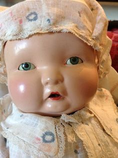 I don& believe there has been any restoration. Cotton hat, robe, and jumper are in good to exc condition. I think theses are original. Face has good bright paint, rosy cheeks, sleep eyes blink well and do not stick. Effanbee Dolls, Bright Paintings, Cotton Hat, Antique Dolls, Baby Dolls, Vintage Outfits, Dimples, Antiques, Jumper