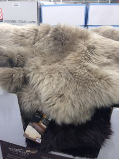 Sheepskin rug - Costco $134.99 grey/beige Value: approx three single nights
