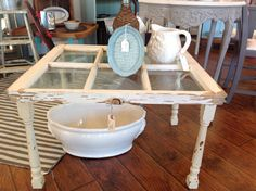 Old window converted into a coffee table, using old spindles, as legs! Fine Furniture, Furniture Projects, Furniture Making, Furniture Design, Furniture Outlet, Refurbished Furniture, Repurposed Furniture, Painted Furniture, Repurposed Shutters