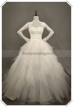 Luxurious long sleeves lace tulle open back wedding dress...I know it will never happen but a girl can dream