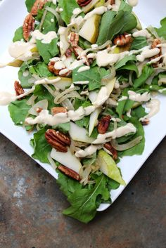 Fall Arugula Salad with fresh pears, toasted pecans, & caramelized onions