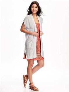 Throw on an open sweater like this one from Old Navy to turn your favorite summer dress into a fall outfit.