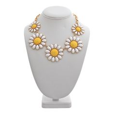 Daisy Necklace - This darling bright necklace will have you all smiles this spring.  Bright daisy jewels join together on a lovely gold link chain.