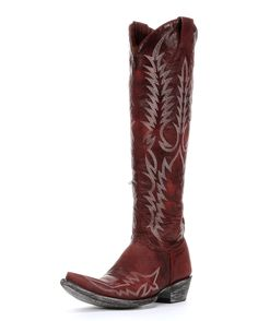 """Turn some heads in these beautiful Mayra Boots from Old Gringo! Made from a rich, distressed red leather, this boot features cream colored embroidery in the classic Mayra pattern. 4 long toe, 1-1/2"""" heel (9964 heel) and an 18"""" shaft with side zipper for easy on and off. Handmade in Mexico."""