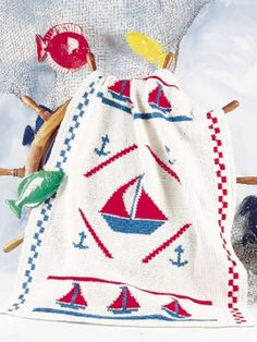 Sail right through this crochet afghan pattern and add it as a special touch to your lake cabin. Or, crochet it as a birthday surprise for your young sailor! Size: 42 x Skill Level: Intermediate Crochet Anchor, Annie's Crochet, Crochet Gratis, Crochet Home, Crochet For Kids, Weighted Blanket Diy, Afghan Crochet Patterns, Crochet Afghans, Baby Afghans